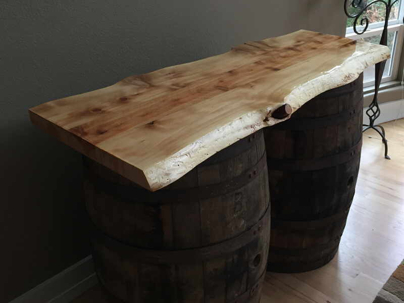 Cedar slab mounted on barrels